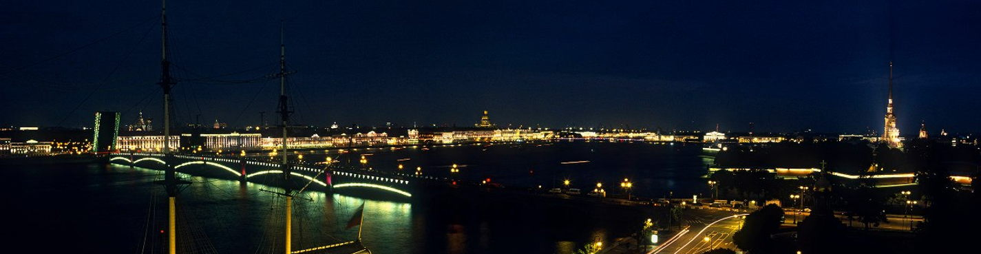 Night roof top tour: panorama of river Neva and opening bridges